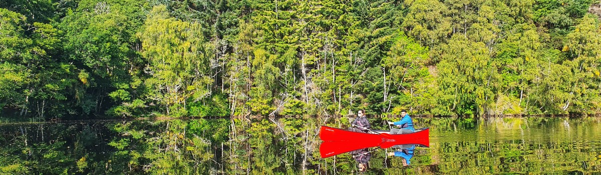 Hou Canoe Reflection shot 1200×350