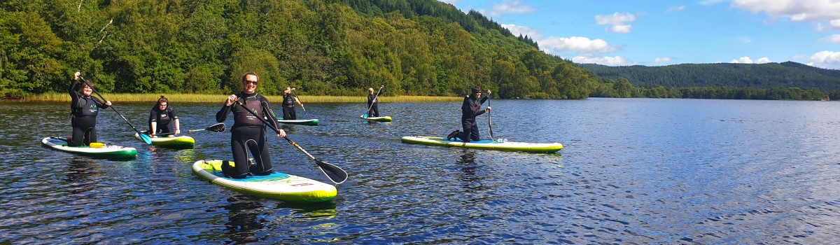 Red SUP Loch Achilty 1 1200×350