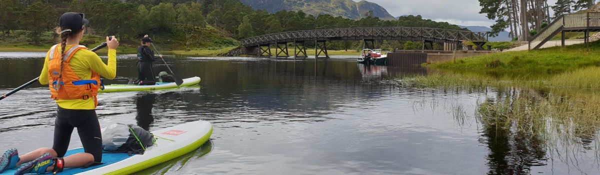 Red SUP Paddling up Loch Affric 1 1200×350