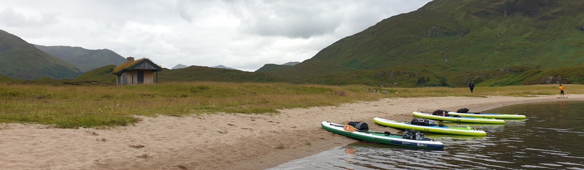 Red SUP Paddling up Loch Affric 2 1200×350